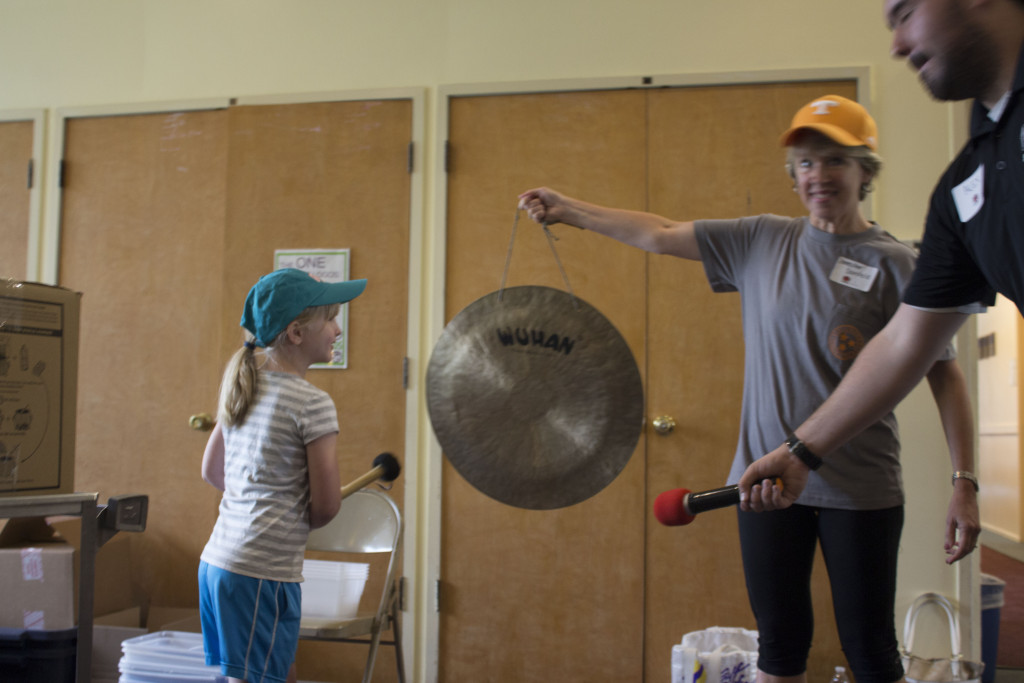 Each time we packaged 1,000 meals, one of our younger volunteers would ring a gong.